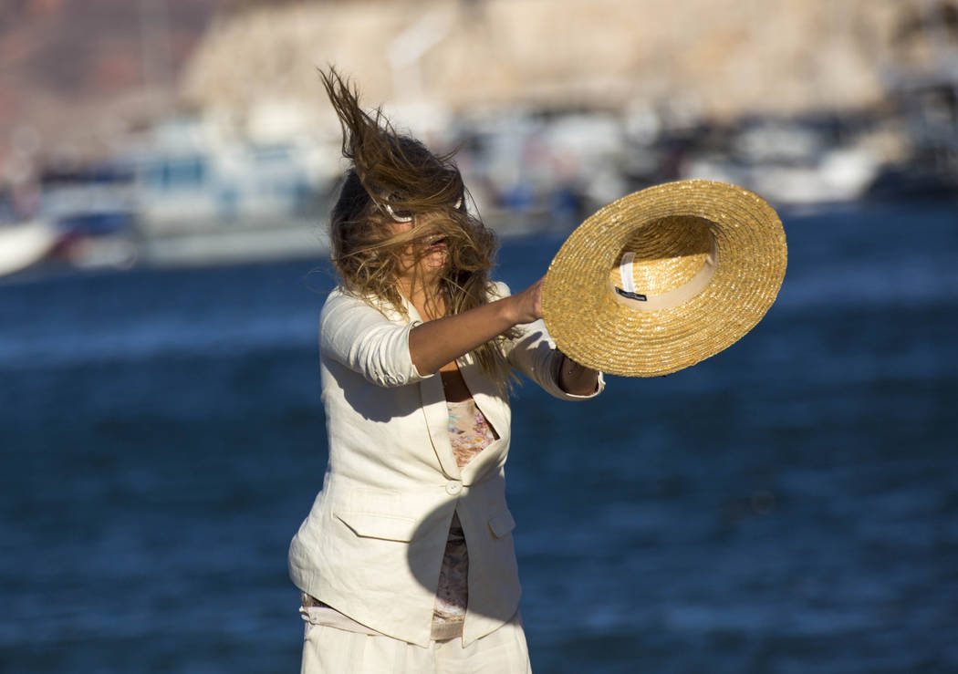 Interior designer Olga Kushko of Ukraine loses her hat to the wind as she poses for a photo at the Las Vegas Boat Harbor at Lake Mead National Recreation Area on Sunday, Oct. 14, 2018. Richard Bri ...