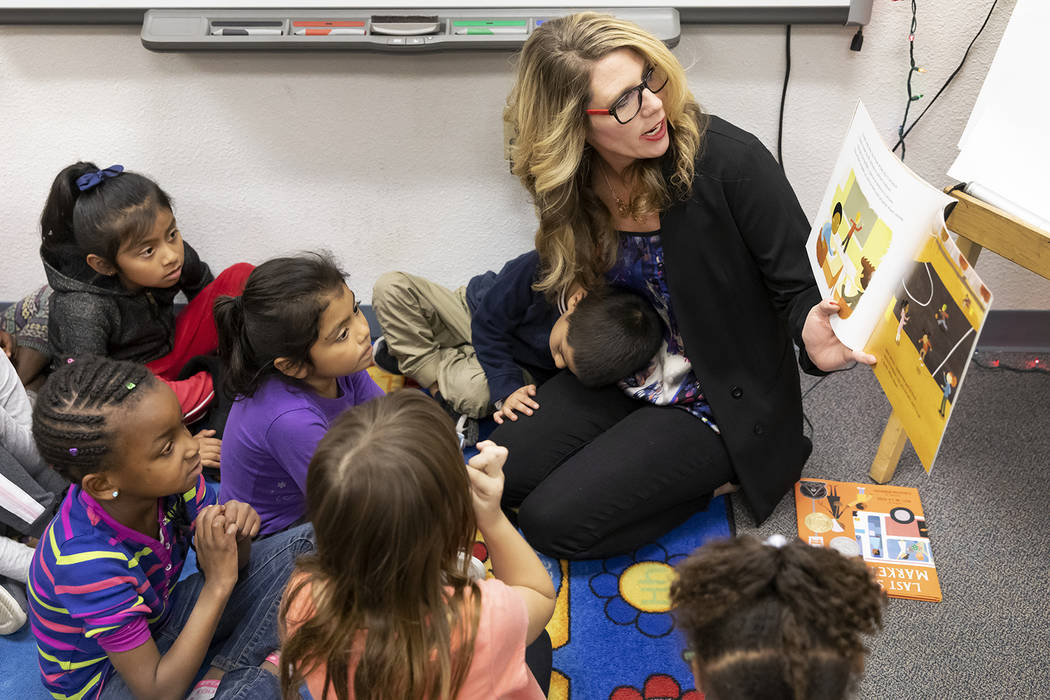Sophie Ladd, an assistant professor in residence at UNLV, reads to children in December at Paradise Elementary School. (Lonnie Timmons III/UNLV Creative Services)