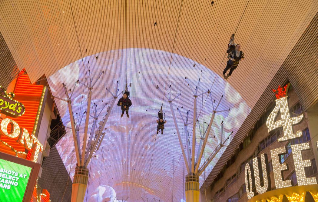 Zip liners pass above the Fremont Street Experience on Wednesday, Jan. 30, 2019, in Las Vegas. (Benjamin Hager/Las Vegas Review-Journal) @BenjaminHphoto