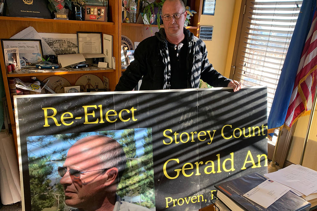 Storey County Sheriff Gerald Antinoro in his Virginia City office with one of his re-election campaign signs. An ethics complaint against him says the sign is among several campaign materials that ...