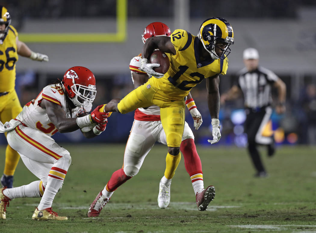 Los Angeles Rams wide receiver Brandin Cooks (12) is tripped up by Kansas City Chiefs free safety Ron Parker, left, during the second half of an NFL football game, Monday, Nov. 19, 2018, in Los An ...