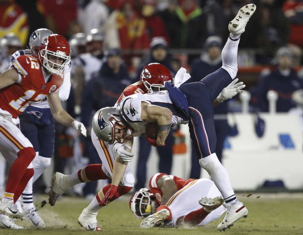 New England Patriots wide receiver Julian Edelman (11) is tackled by Kansas City Chiefs linebacker Frank Zombo (51) during the second half of the AFC Championship NFL football game, Sunday, Jan. 2 ...