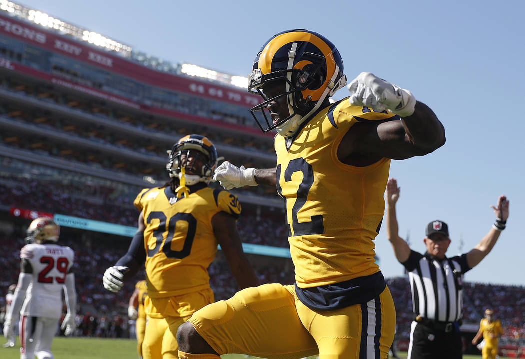In this Oct. 21, 2018, file photo, Los Angeles Rams wide receiver Brandin Cooks (12) celebrates after scoring a touchdown against the San Francisco 49ers during the first half of an NFL football g ...