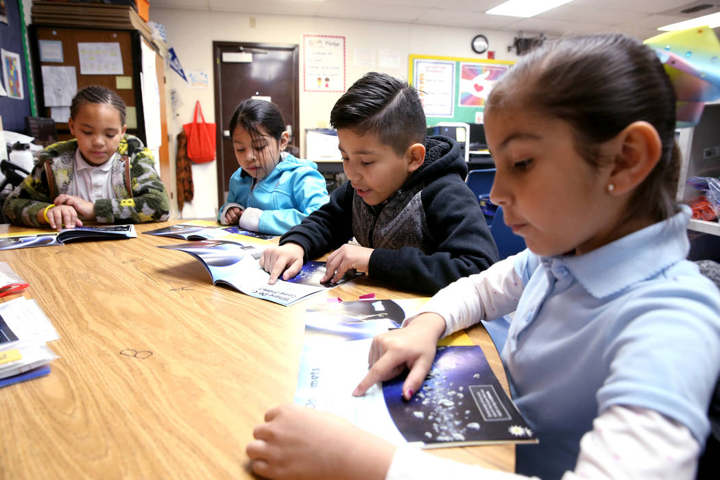 Second graders, from left, Skylar Kaufman, Mildred Navarro-Can, Christopher Olguin and Kayla Enriquez read in the Zoom Reading Center at Tate Elementary in Las Vegas Thursday, Jan. 17, 2019. (K.M. ...