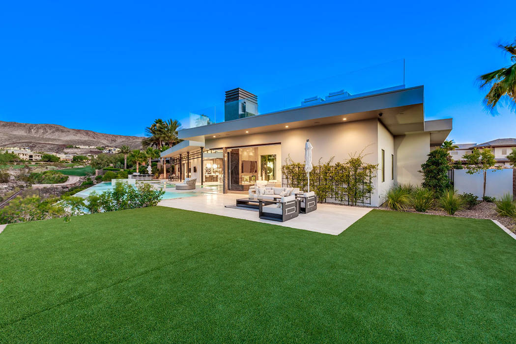 The side yard offers plenty of grassy area. (Ivan Sher Group)