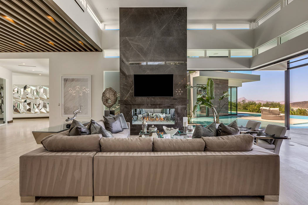 A large fireplace is the centerpiece for the living room. (Ivan Sher Group)
