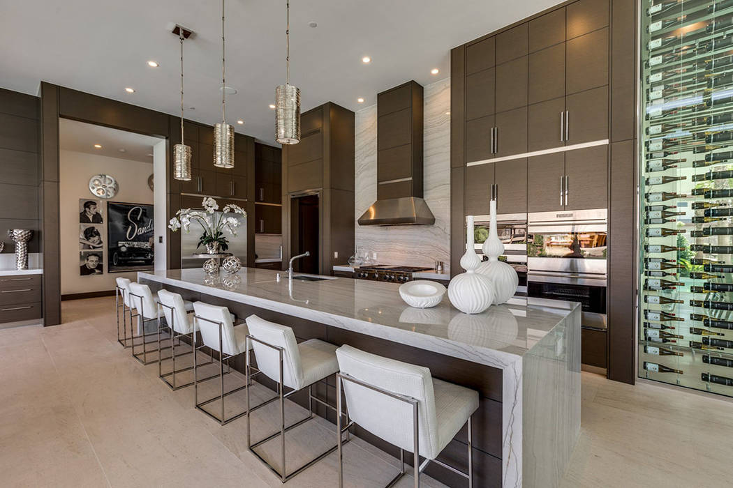 The kitchen offers a large island with seating. (Ivan Sher Group)