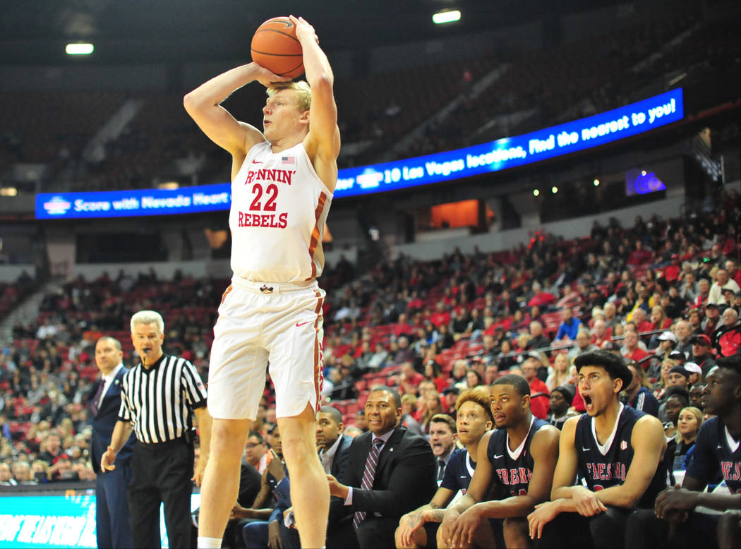 UNLV Rebels guard Trey Woodbury (22) takes a three-point shot during the first half of a game between UNLV and Fresno State at the Thomas & Mack Center in Las Vegas, on Saturday, Feb. 9, 2019. ...