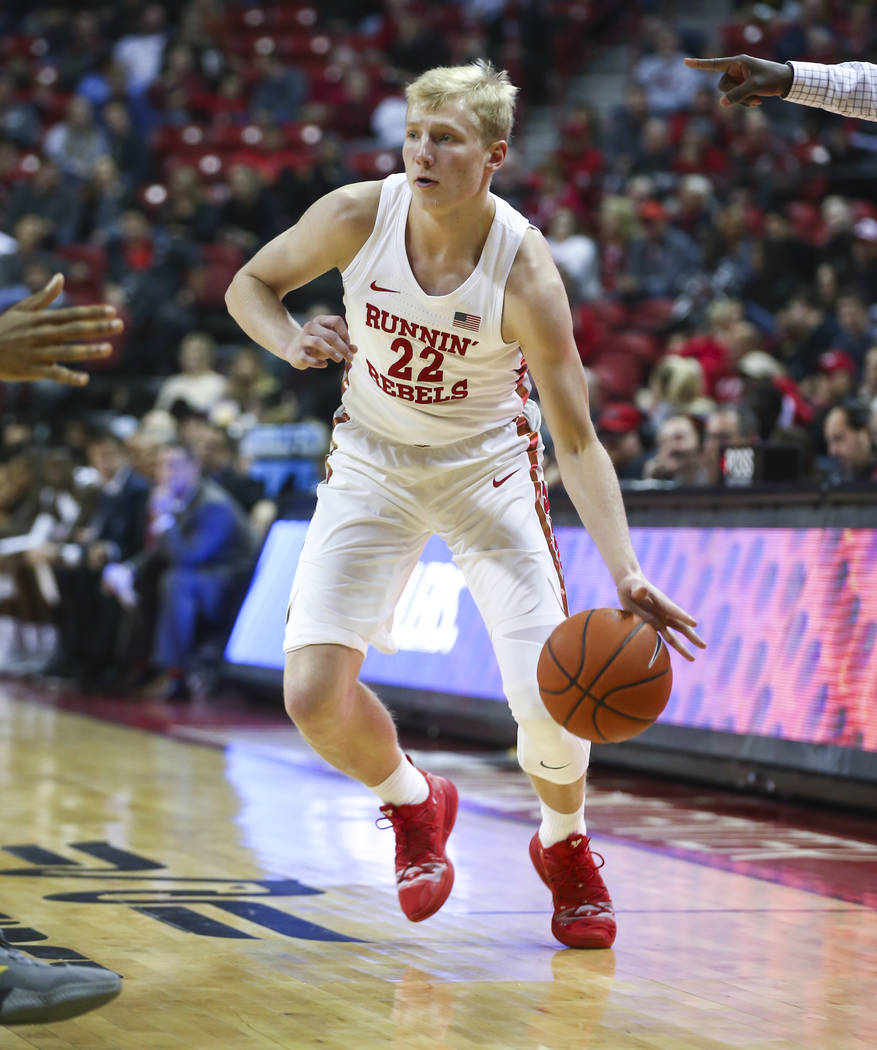 UNLV Rebels guard Trey Woodbury (22) moves the ball against Wyoming during the first half of a basketball game at the Thomas & Mack Center in Las Vegas on Saturday, Jan. 5, 2019. Chase Stevens Las ...