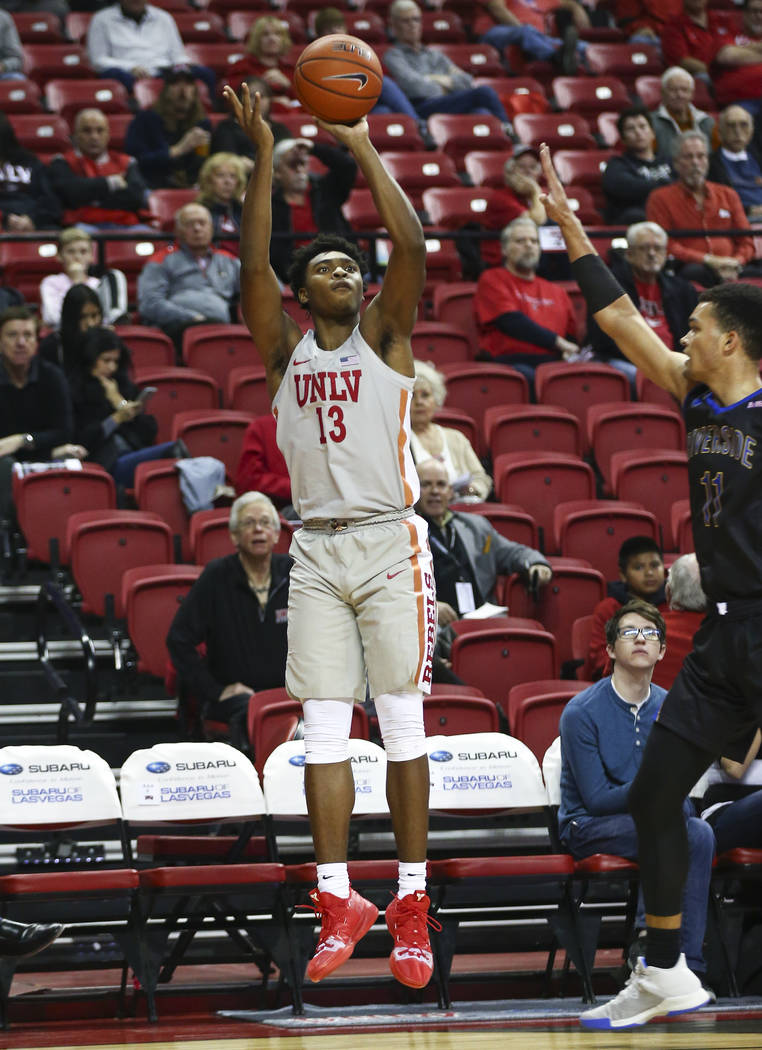 UNLV Rebels guard Bryce Hamilton (13) shoots to score a three-pointer against the UC Riverside Highlanders during the first half of a basketball game at the Thomas & Mack Center in Las Vegas on Tu ...