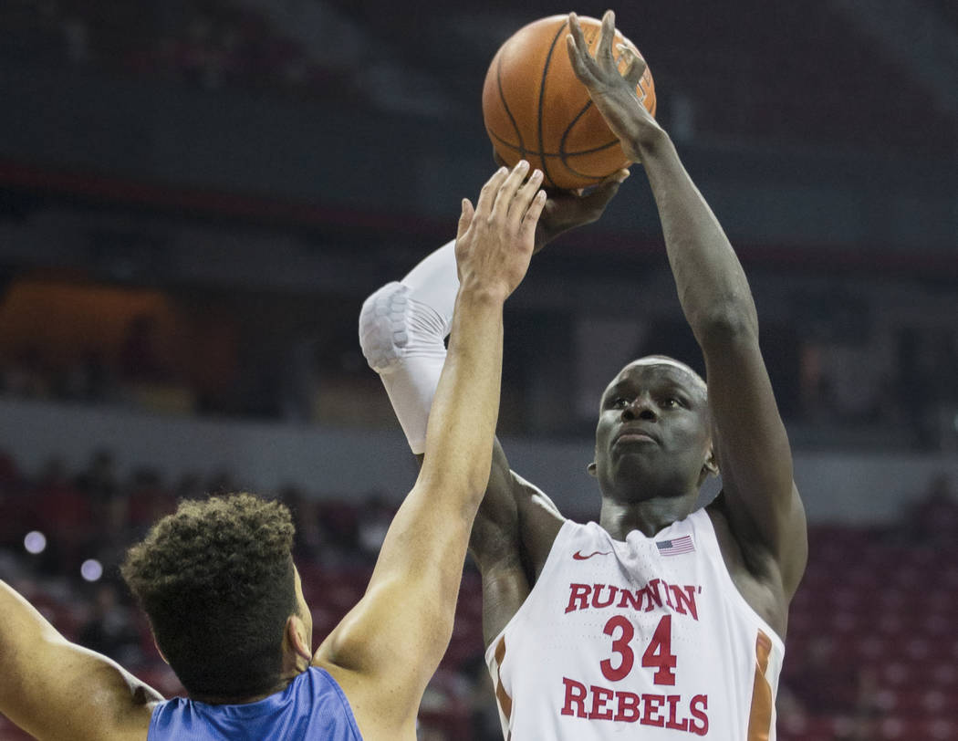 UNLV sophomore forward Cheikh Mbacke Diong (34) shoots a jump shot over Air Force junior forward Ryan Swan (34) in the first half on Tuesday, Feb. 12, 2019, at the Thomas & Mack Center, in Las ...
