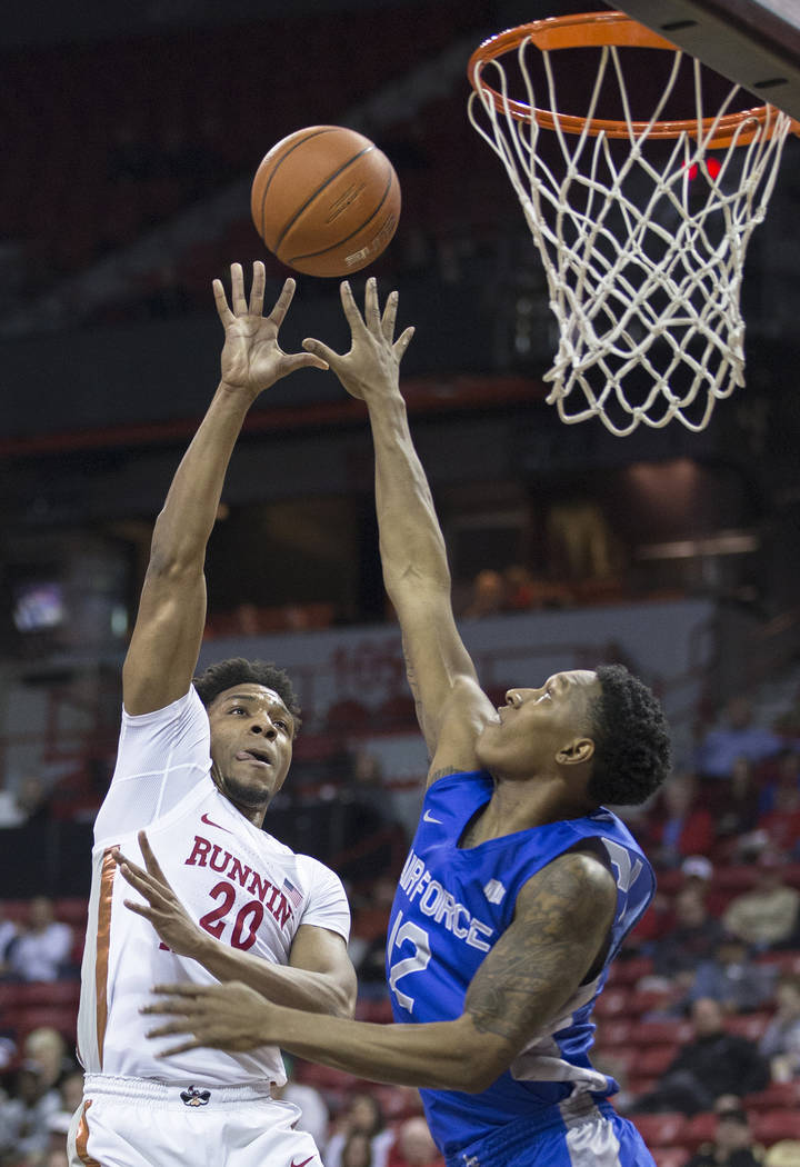 UNLV junior forward Nick Blair (20) shoots over Air Force junior forward Lavelle Scottie (12) in the second half on Tuesday, Feb. 12, 2019, at the Thomas & Mack Center, in Las Vegas. Review-Jo ...