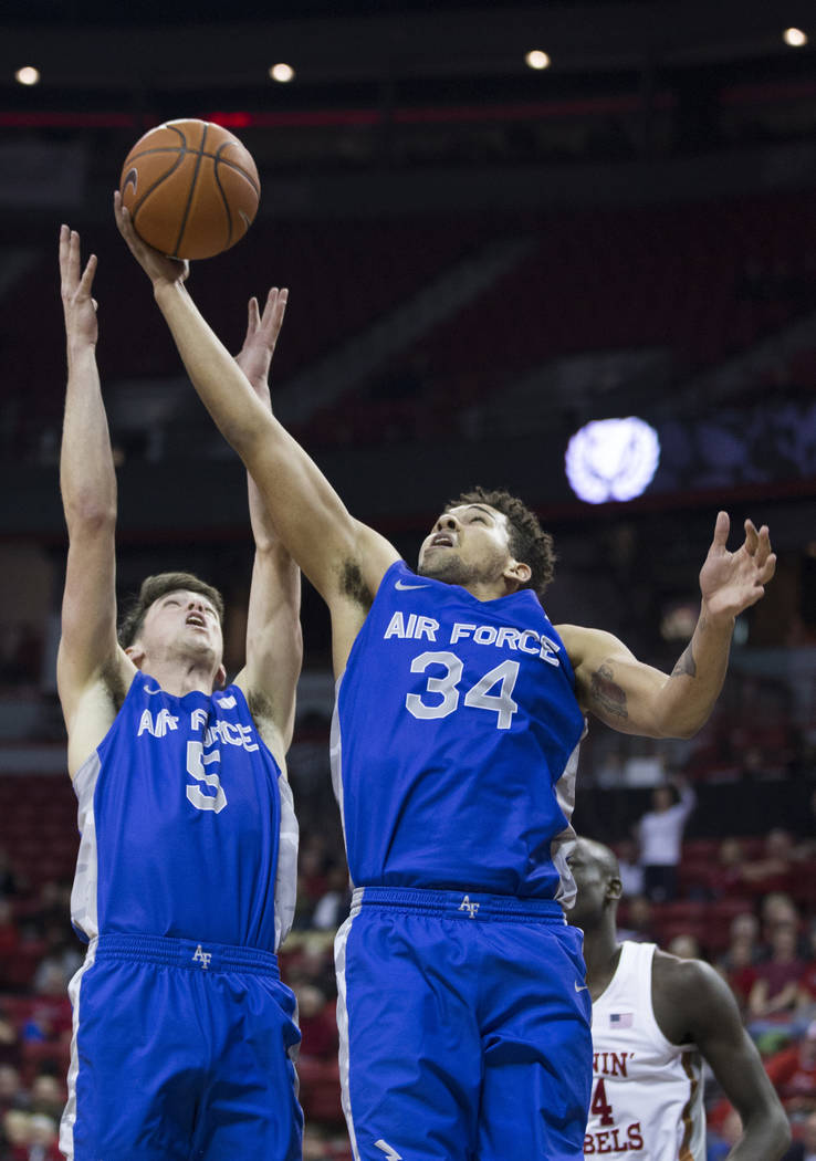 Air Force junior forward Ryan Swan (34) grabs a rebound in the second half during the Falcons road matchup with UNLV on Tuesday, Feb. 12, 2019, at the Thomas & Mack Center, in Las Vegas. Revie ...