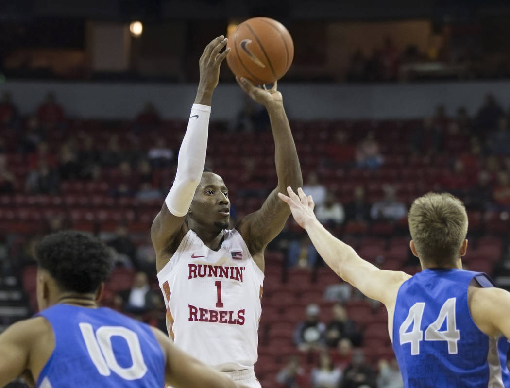 UNLV senior guard Kris Clyburn (1) shoots a three point shot over Air Force sophomore guard Keaton Van Soelen (44) in the second half on Tuesday, Feb. 12, 2019, at the Thomas & Mack Center, in ...