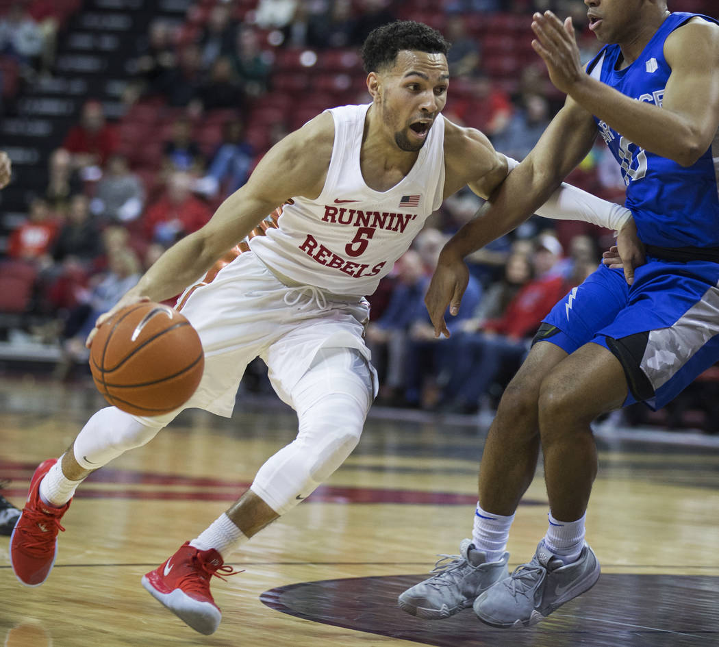 UNLV senior guard Noah Robotham (5) drives past Air Force freshman guard A.J. Walker (10) in the second half on Tuesday, Feb. 12, 2019, at the Thomas & Mack Center, in Las Vegas. Review-Journa ...