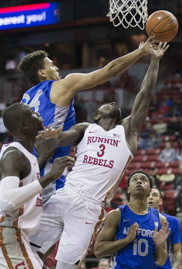 UNLV sophomore guard Amauri Hardy (3) gets fouled on the way to the basket by Air Force junior forward Ryan Swan (34) in the second half on Tuesday, Feb. 12, 2019, at the Thomas & Mack Center, ...