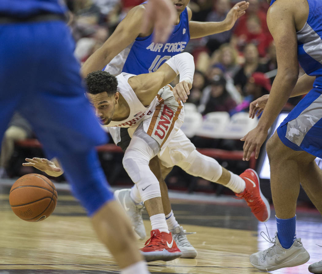 UNLV senior guard Noah Robotham (5) drives past Air Force defenders in the second half on Tuesday, Feb. 12, 2019, at the Thomas & Mack Center, in Las Vegas. Review-Journal) @BenjaminHphoto