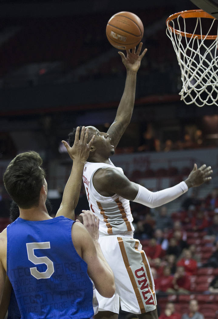 UNLV senior guard Kris Clyburn (1) slices to the rim past Air Force sophomore guard Chris Joyce (5) in the second half on Tuesday, Feb. 12, 2019, at the Thomas & Mack Center, in Las Vegas. Rev ...