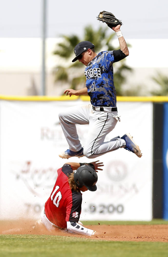 UNLV'S Bryson Stott (10) slides safely into second base against Air Force's Christian Gambale (1) during the fourth inning at the Earl Wilson Stadium in Las Vegas on Sunday, April 15, 2018. Andrea ...