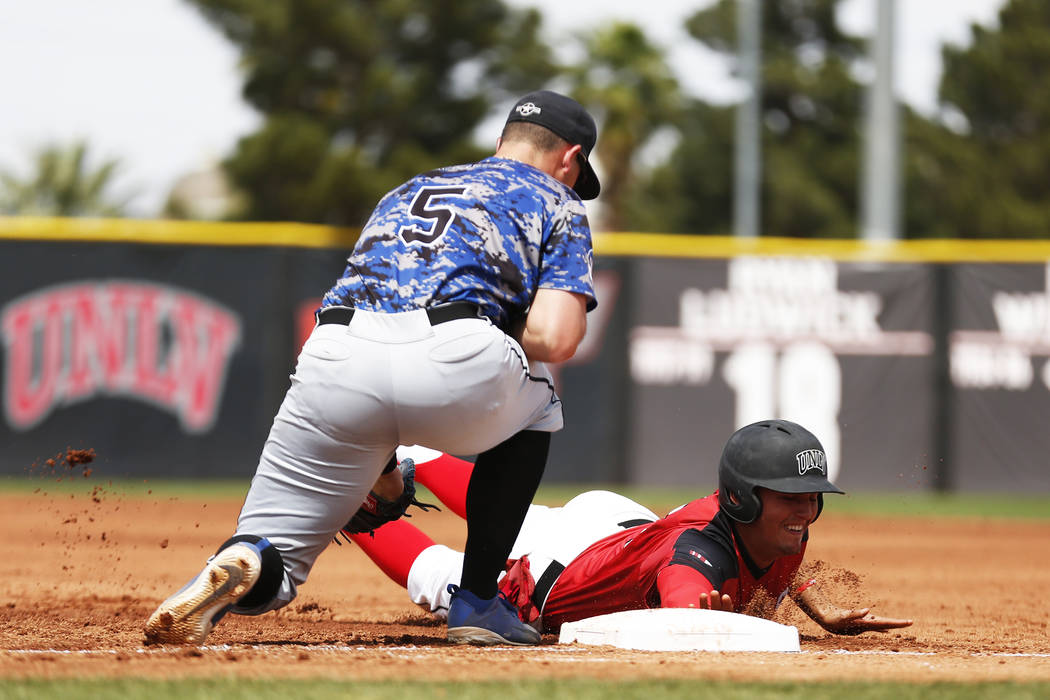 UNLV'S Dillon Johnson (25) dives safely back into first after a pick off attempt against Air Force's Nic Ready (5) during the second inning at the Earl Wilson Stadium in Las Vegas on Sunday, April ...