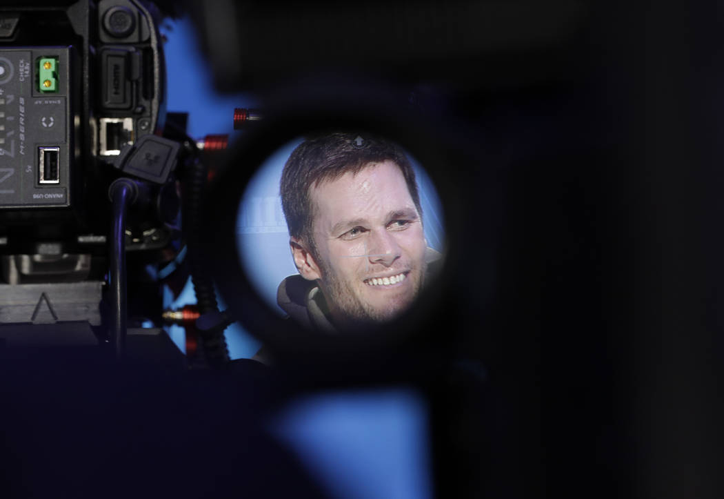 New England Patriots' Tom Brady is videotaped during Opening Night for the NFL Super Bowl 53 football game Monday, Jan. 28, 2019, in Atlanta. (AP Photo/David J. Phillip)