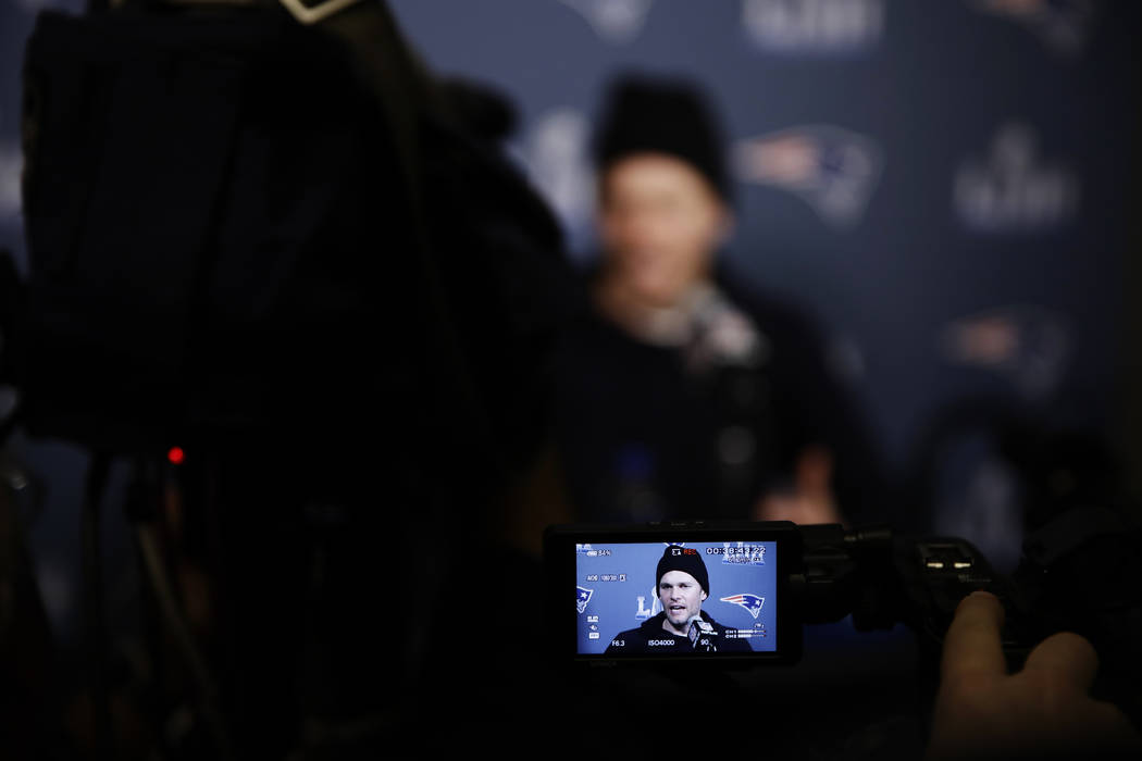 New England Patriots quarterback Tom Brady speaks with members of the media during a news conference Wednesday, Jan. 30, 2019, ahead of the NFL Super Bowl 53 football game against Los Angeles Rams ...