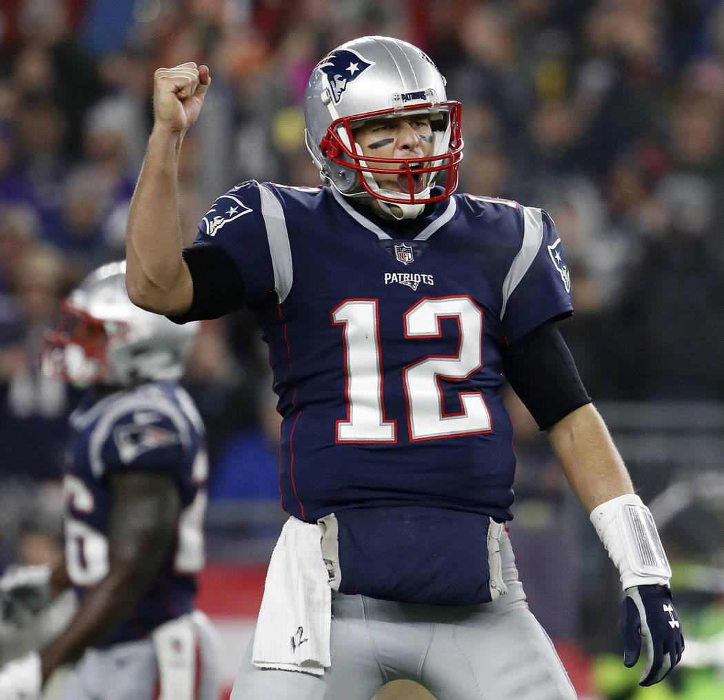 In this Dec. 2, 2018, file photo, New England Patriots quarterback Tom Brady celebrates a touchdown during an NFL football game against the Minnesota Vikings at Gillette Stadium in Foxborough, Mas ...