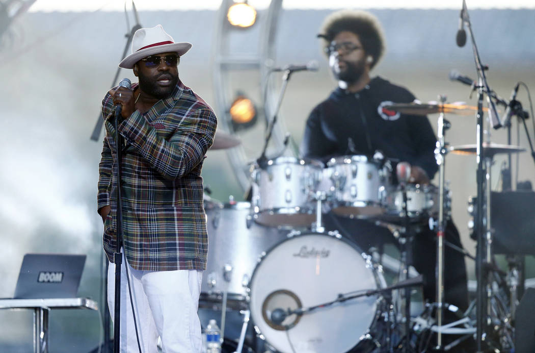 """In this July 4, 2014 file photo, Tariq """"Black Thought"""" Trotter, left, and Ahmir """"Questlove"""" Thompson of The Roots, perform during an Independence Day celebration in Philadelphia. The Roots are tap ..."""