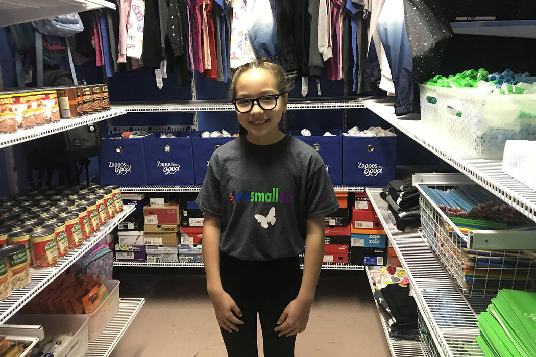 Alfonsina Zorono, 11, stands in the middle of a new closet at Rundle Elementary supplied with food, clothes, school supplies and shoes. (Mia Sims/Las Vegas Review-Journal @miasims___)