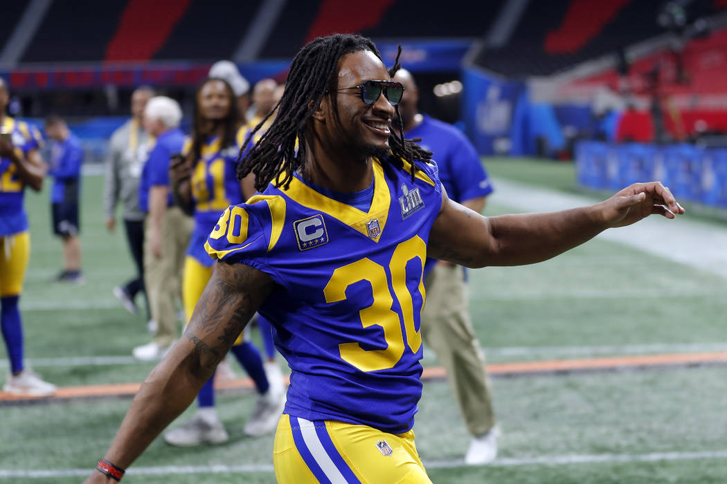 Los Angeles Rams running back Todd Gurley (30) rushes to join teammates for a photograph during walkthrough at the Mercedes Benz Stadium for the NFL Super Bowl 53 football game against the New Eng ...