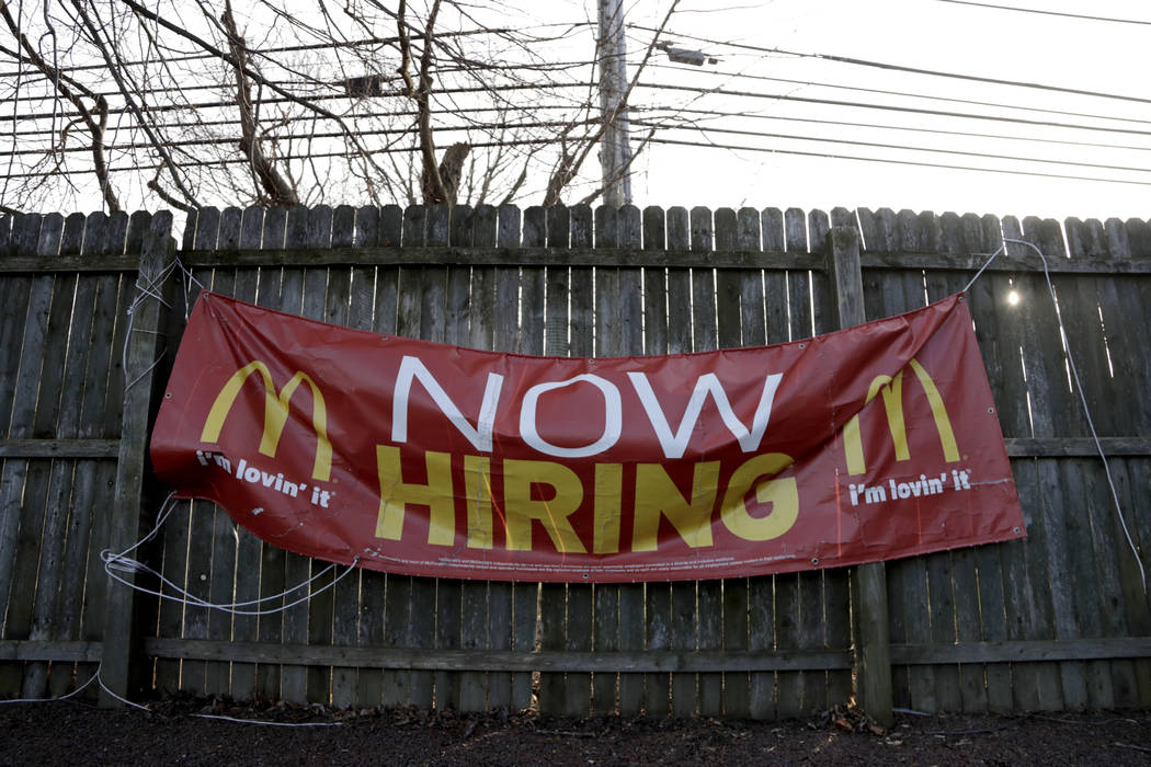 The U.S. government's January jobs report issued on Friday said that 304,000 jobs were added, the most in nearly a year. (Julio Cortez/AP, File)