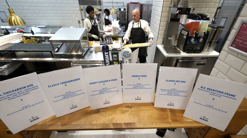 Food is prepared for a media tasting event during a tour of Mercedes-Benz Stadium for the NFL Super Bowl 53 football game Tuesday, Jan. 29, 2019, in Atlanta. (AP Photo/David J. Phillip)