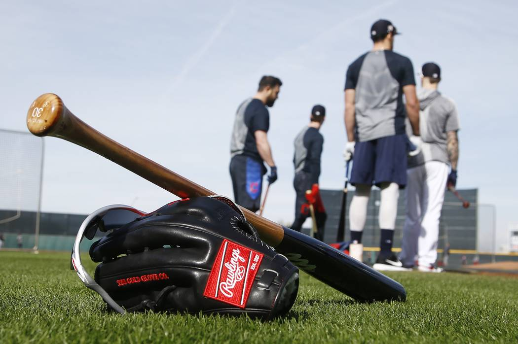 Cleveland Indians players wait their turn for batting practice during informal workouts at the team training facility Friday, Feb. 15, 2019, in Goodyear, Ariz. (AP Photo/Ross D. Franklin)