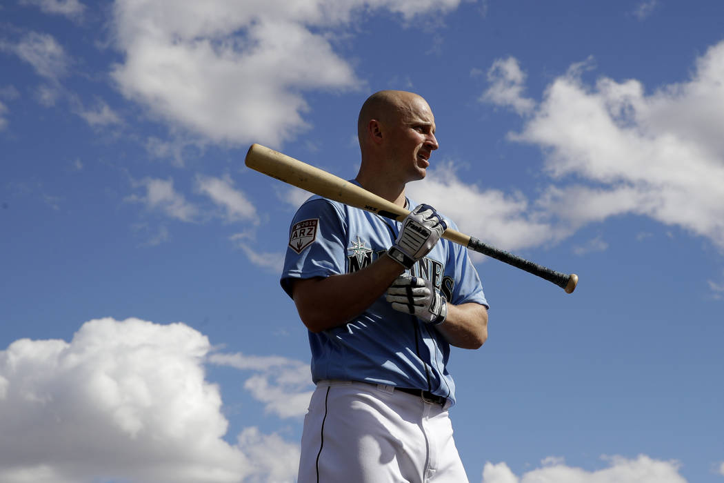 Seattle Mariners' Kyle Seager waits to bat during spring training baseball practice Saturday, Feb. 16, 2019, in Peoria, Ariz. (AP Photo/Charlie Riedel)