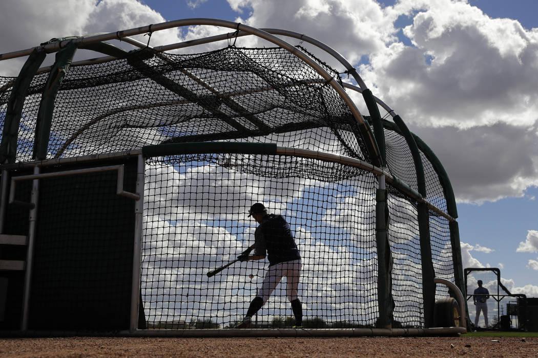 Seattle Mariners' Ichiro Suzuki bats during baseball spring training Saturday, Feb. 16, 2019, in Peoria, Ariz. (AP Photo/Charlie Riedel)
