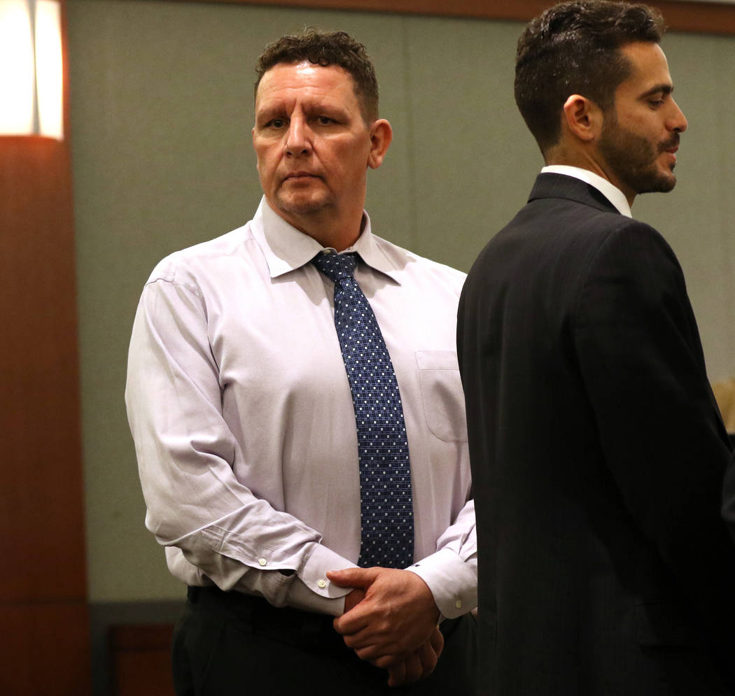 Christopher Sena, left, who is accused of sexually abusing at least seven children, stands next to his attorney David Lopez-Negrete as the jury enters the courtroom during his trial at the Regiona ...