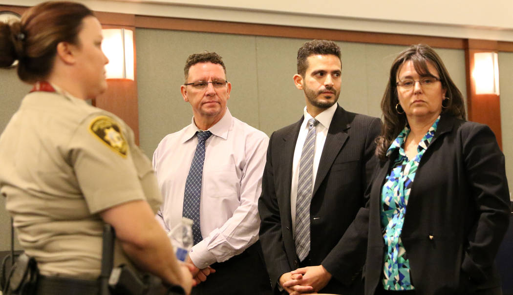 Christopher Sena, left, who is accused of sexually abusing at least seven children, rises with his attorneys David Lopez-Negrete, center, and Violet Radosta at his trial at the Regional Justice Ce ...