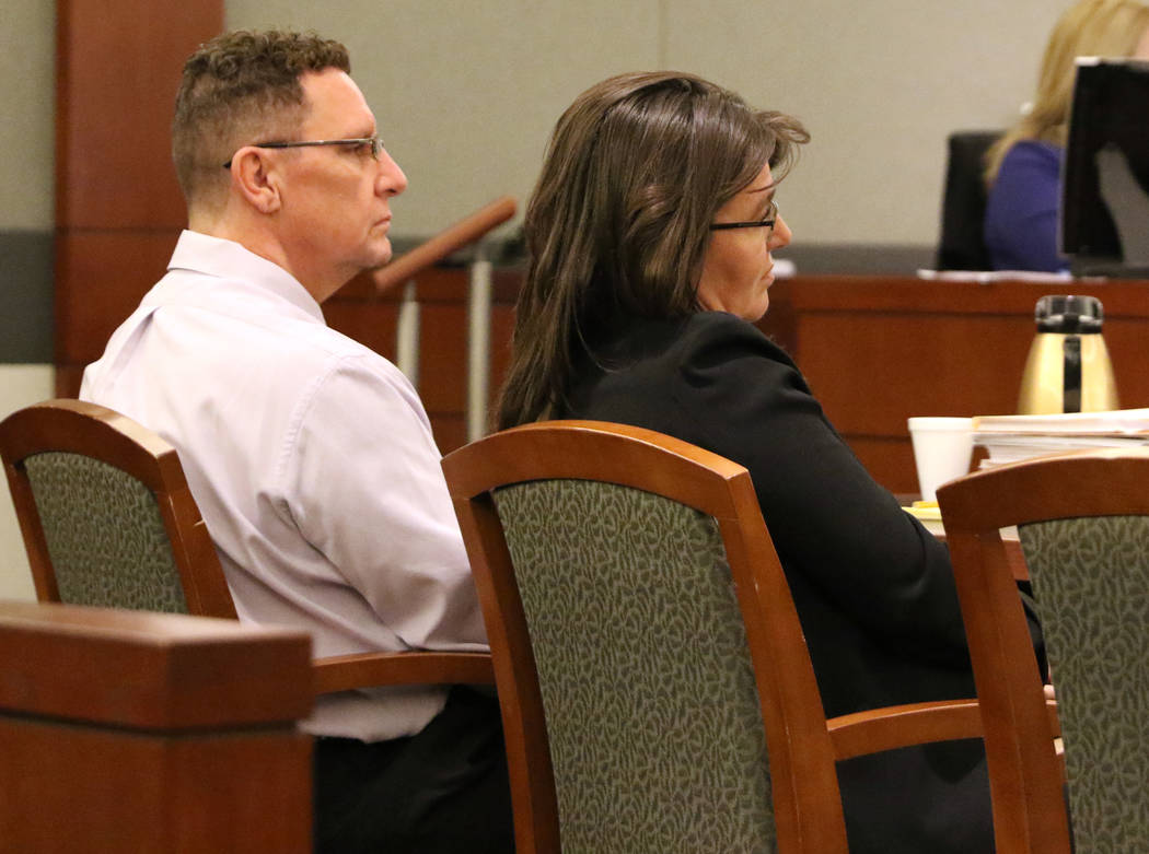 Christopher Sena, left, who is accused of sexually abusing at least seven children, listens to his attorney David Lopez-Negrete, not pictured, present the opening statement in his case as he sits ...