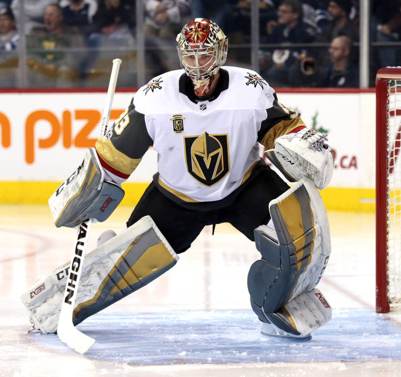 Dec 1, 2017; Winnipeg, Manitoba, CAN; Vegas Golden Knights goalie Maxime Lagace (33) warms up prior to the start of the second period at Bell MTS Place. (James Carey Lauder-USA TODAY Sports)