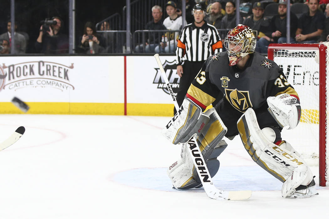 Golden Knights goaltender Maxime Lagace (33) defends the goal as the team plays the New Jersey Devils during the second period of an NHL hockey game at T-Mobile Arena in Las Vegas on Wednesday, Ma ...