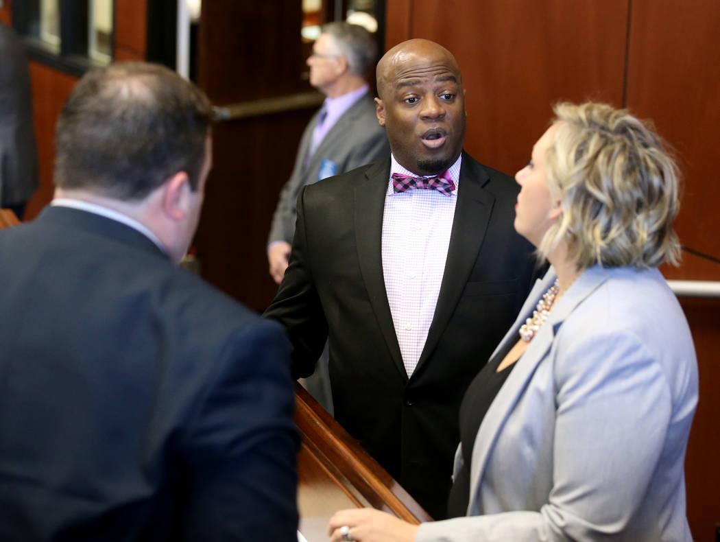 Senate Majority Leader Kelvin Atkinson, D-Las Vegas, center, meets with Sen. James Ohrenschall, D-Las Vegas, and Sen. Nicole Cannizzaro, D-Las Vegas, after a brief floor session in the Legislative ...