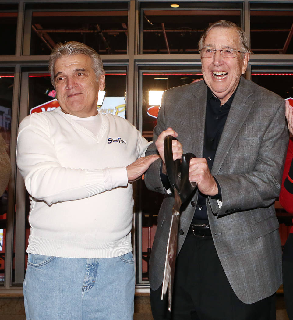 Jimmy Vaccaro, VSiN expert oddsmaker, left, and Brent Musburger, manager editor and lead host of VSiN, participate in VSiN studio's ribbon cutting ceremony on Friday, Feb. 3, 2017, at South Point ...