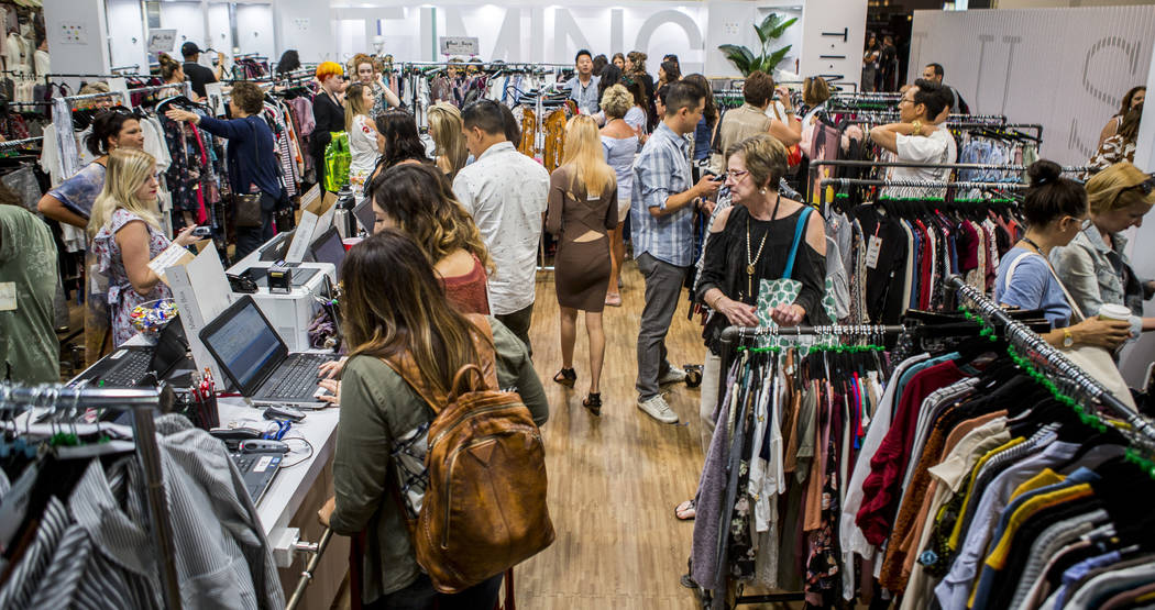 Attendees browse clothes from Timing at the MAGIC trade show inside the Las Vegas Convention Center on Tuesday, Aug. 15, 2017. Patrick Connolly Las Vegas Review-Journal @PConnPie