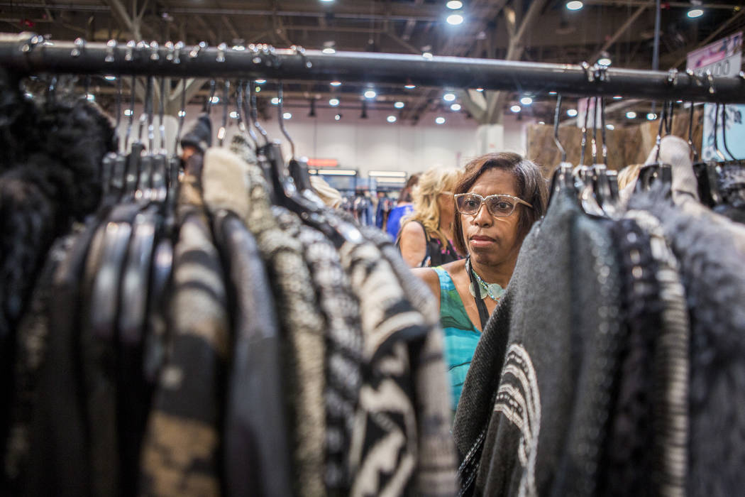 Marilyn Craig of Southfield, Mich., browses clothes by Nostalgia at the MAGIC trade show inside the Las Vegas Convention Center on Tuesday, Aug. 15, 2017. Patrick Connolly Las Vegas Review-Journa ...