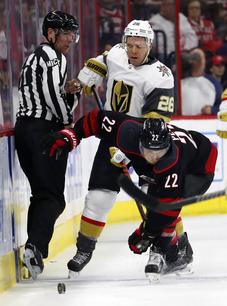 Carolina Hurricanes' Brett Pesce (22) collides with Vegas Golden Knights' Paul Stastny (26) during the third period of an NHL hockey game Friday, Feb. 1, 2019, in Raleigh, N.C. (AP Photo/Karl B De ...