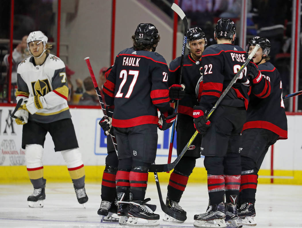 The Carolina Hurricanes celebrate a goal by Brett Pesce (22) during the second period of an NHL hockey game against the Vegas Golden Knights on Friday, Feb. 1, 2019, in Raleigh, N.C. (AP Photo/Kar ...