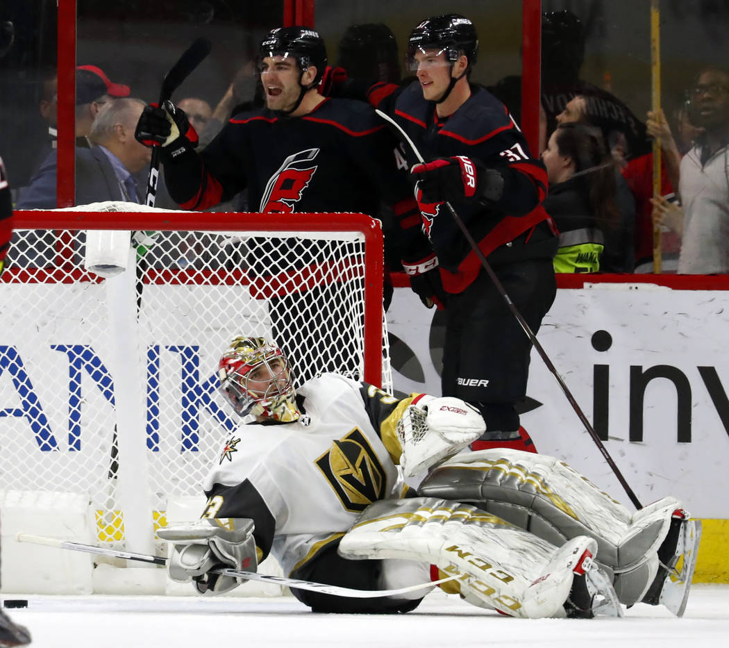 Carolina Hurricanes' Jordan Martinook (48) celebrates his goal with teammate Andrei Svechnikov (37) behind Vegas Golden Knights goaltender Maxime Lagace (33) during the second period of an NHL hoc ...