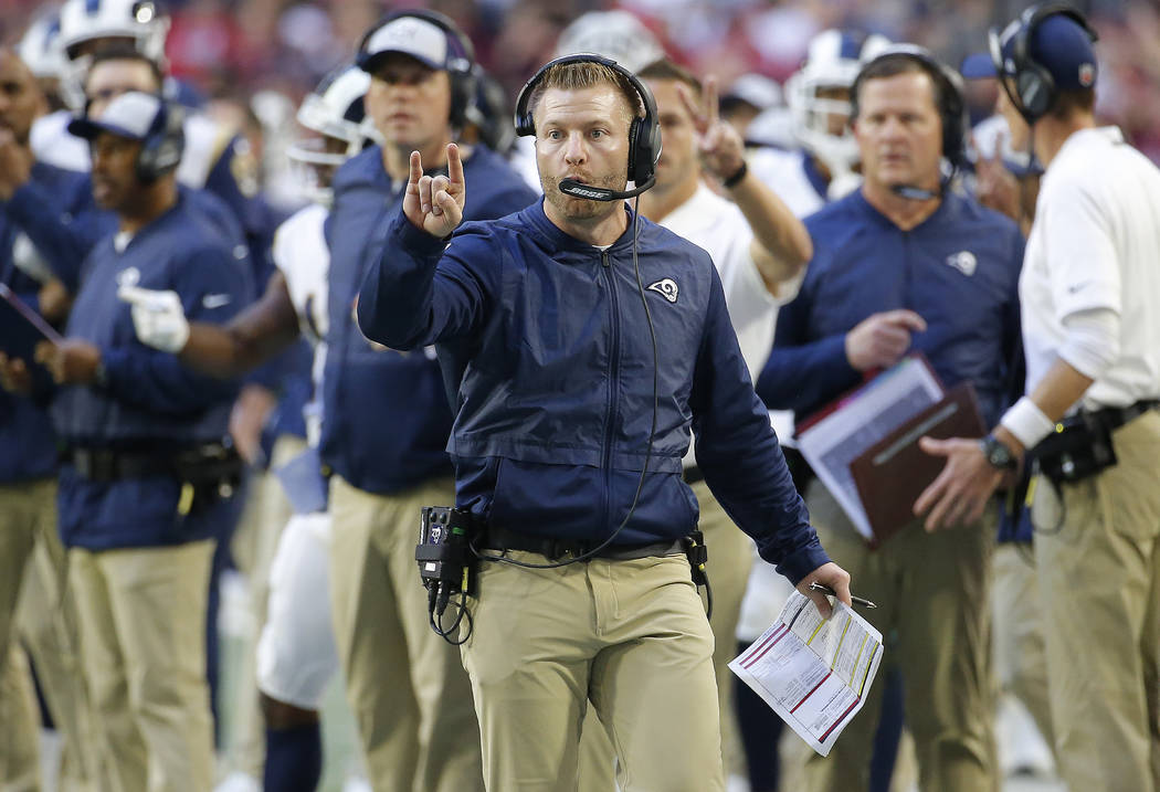 In this Sunday, Dec. 23, 2018 file photo, Los Angeles Rams head coach Sean McVay makes a call against the Arizona Cardinals during the second half of an NFL football game in Glendale, Ariz. (AP Ph ...