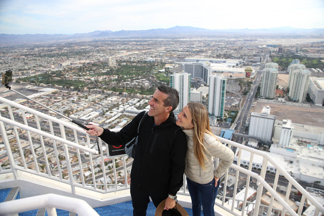 Pablo Goncalves, left, and Laura Fernandez, take a photo together at the Stratosphere's observation deck in Las Vegas, Friday, Feb. 1, 2019. Erik Verduzco/Las Vegas Review-Journal) @Erik_Verduzco