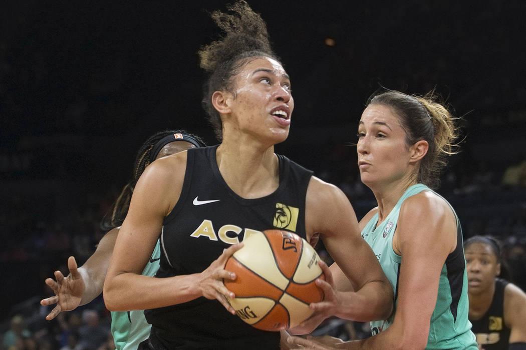 Aces forward Dearica Hamby (5) drives past New York Liberty guard Rebecca Allen (9) in the second quarter on Wednesday, Aug. 15, 2018, at the Mandalay Bay Events Center, in Las Vegas. Benjamin Hag ...